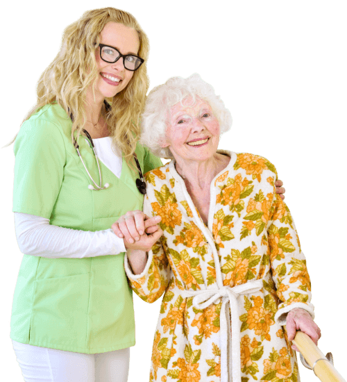 caregiver and senior woman smiling at the camera